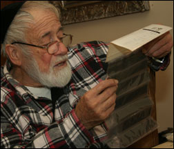 Yossi Melamed reviews one of his preserved negatives.