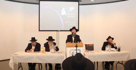 Rabbi Shmuel Kaminetzki, Chief Rabbi of Dnepropetrovsk, Ukraine, addresses the young men, as Rabbis Moshe and Mendel Kotlarsky and Yosef C. Kantor look on.