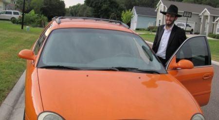 Zalman with our flashy orange car.