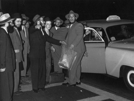 This photograph was snapped of early group about to depart for rural America.