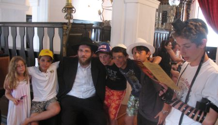 With a group of Jewish kids in the ancient synagogue.
