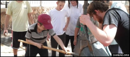 Students from the Ohr Menachem boys' school in Arad, Israel, partner with students from the University of Vermont to build seats for the school's basketball court from recycled materials.