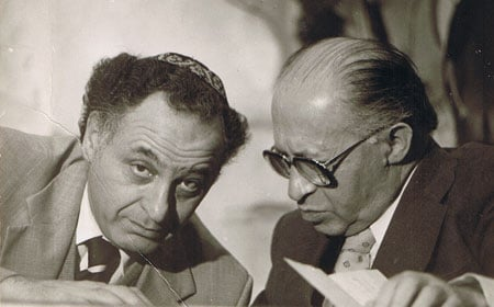 Prime Minister Begin consults with his aide Yehuda Avner. (Photo courtesy of Yehuda Avner)