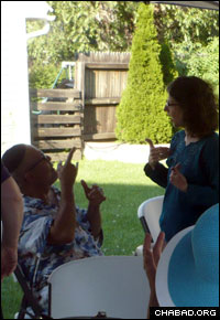 Conversing at a welcome barbeque that introduced the rabbinical students to Rochester's deaf Jewish community.