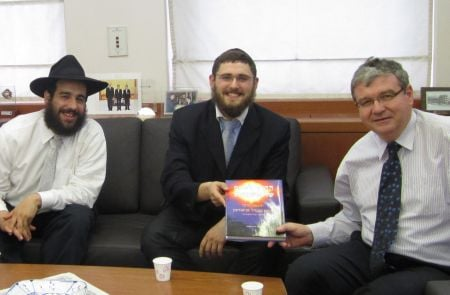 Roving Rabbis, Moshe Frank and Berri Spitezki with Mr. Tuvia Israeli, Israeli Ambassador to S. Korea, with the book that led us to the story.
