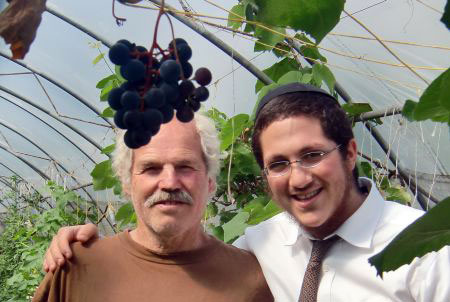 With an Israeli in his vineyard.