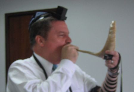 The Prime Minister trying his hand as the shofar.