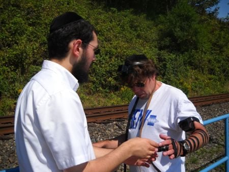 Stu laying tefillin for the first time in his life.