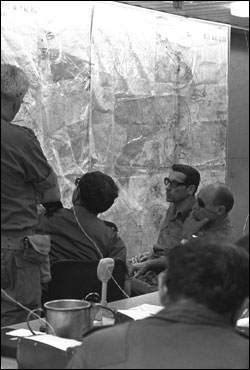 "The Israeli Defense Force generals gather in the ""war room"" in early October, 1973. (Photo: Arad Shlomo/GPO)"