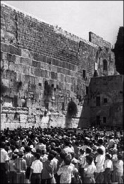 Kids gather at the Western Wall to pray after the call of the Rebbe, Rabbi Menachem Mendel Schneerson, of righteous memory.