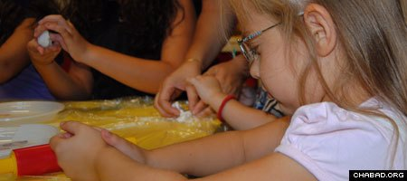 Students at the first Jewish preschool to open in Serbia in more than 50 years learn how to make challah bread.