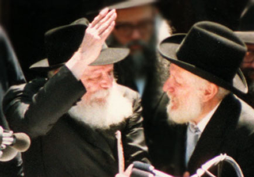 "The Rebbe, of righteous memory, motions upwards with his hands to Rabbi Yaakov Yehudah (""JJ"") Hecht following a parade to bolster to Jewish unity. Rabbi Hecht had told the Rebbe that the great turnout at the parade ""pulled him out"" of his unfounded worries that it would not be successful; the Rebbe responded that the turnout ""uplifted him."" (Photo: A. Raskin/Lubavitch Archives)"