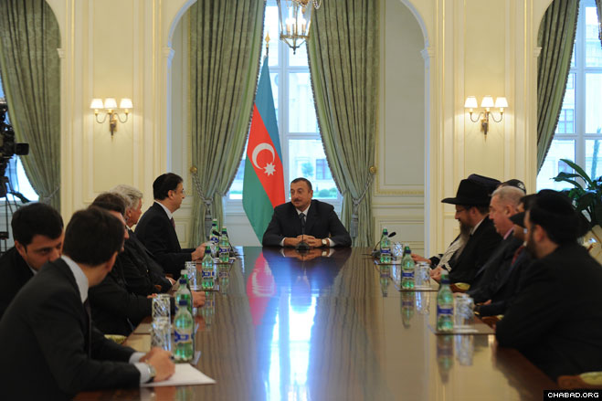 Businessman and President of the Federation of Jewish Communities in the CIS Lev Leviev addresses Azerbaijani President Ilham Aliyev at a meeting prior to the grand opening of the new Chabad Ohr Avner day school in Baku.