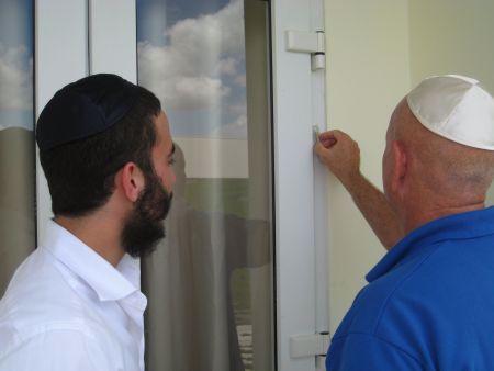 Installing a mezuzah.