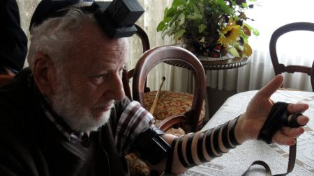 This man from the southern city of Temucon prays in tefillin for the first time in his life.