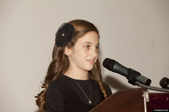 Chaya Grossbaum, daughter of Chabad-Lubavitch of Livingston directors Rabbi Zalman and Toba Grossbaum, addresses guests at her Oct. 14 Bat Mitzvah celebration at the Alex Aidekman Jewish Community Campus in Whippany, N.J.