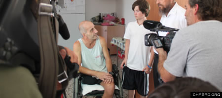 Tyler Hochman was followed by Israeli media as he delivered wheelchairs to organizations and needy individuals this summer.