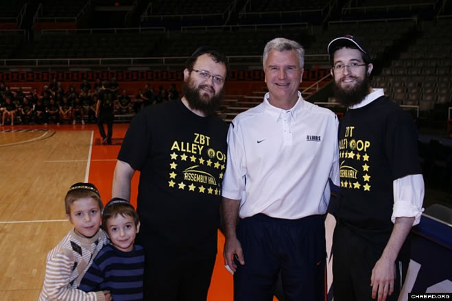 """Rabbis Zelik Moscowitz, right, director of the Friendship Circle of Illinois, and Dovid Tiechtel, executive director of the Chabad Center for Jewish Life serving the University of Illinois at Urbana-Champaign, partnered with Fighting Illini head coach Bruce Weber for the fourth-annual """"Alley-oop for Autism."""""""