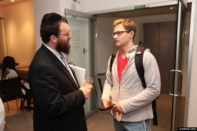 Rabbi Dovid Tiechtel, co-director of the Chabad Center for Jewish Life serving the University of Illinois at Urbana-Champaign, greets a participant at the National Leadership Conference of Chabad on Campus.