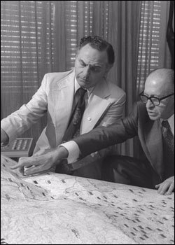 Prime Minister Begin and Mr. Yehuda Avner review a map of Israel.