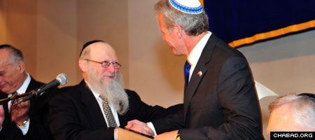 Israeli Ambassador to the U.S. Michael B. Oren receives an honorary law degree from Chabad-Lubavitch Rabbi Moshe Herson, dean of the Rabbinical College of America, at the institutions 40th anniversary dinner in Newark, N.J. (Photo: Michael Livshin)