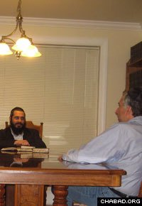 Rabbi Yossi Stein learns with a Jewish community member in Altoona, Pa.