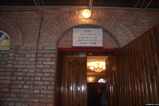 An open door beckons visitors to the structure encompassing the resting place of the First Chabad Rebbe, Rabbi Schneur Zalman of Liadi, in Haditch, Ukraine.
