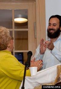 Rabbi Zev Johnson, on-campus rabbi at the Chabad-Lubavitch Jewish Student Center applauds his grandmother's speech.