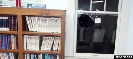 A rock hurled through the center window of the Chabad House Jewish Student Center at Indiana University Bloomington left shards of shattered glass spread like tiny icicles across the entire sanctuary.