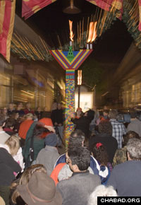 A menorah made out of Lego building blocks wows a crowd.