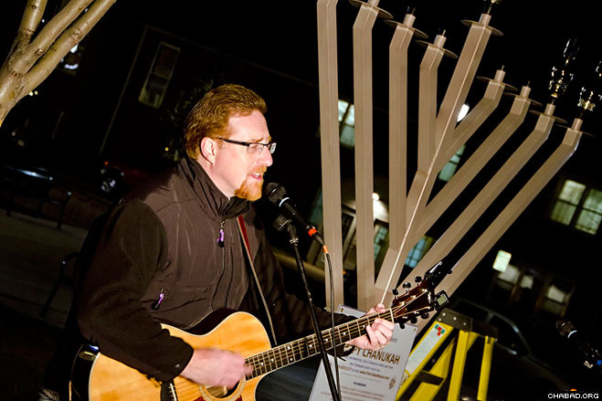Guest performer Steve Brodsky played Chanukah tunes for about 200 people gathered at Arvada, Colo.'s Olde Town Square for a Dec. 2 menorah lighting organized by Chabad-Lubavitch of Northwest Metro Denver.
