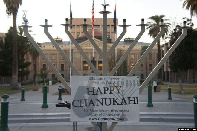 Chabad-Lubavitch of Arizona's menorah returned to the state capitol this Chanukah after Gov. Jan Brewer signed an executive order prohibiting state agencies from preventing public holiday celebration