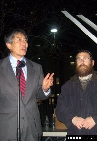 University of Maryland president Wallace Loh talks about Chanukah at a public menorah lighting ceremony coordinated by Rabbi Eli Backman.