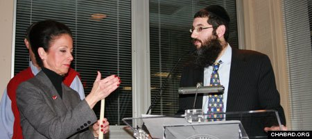 Bradley University president Joanne K. Glasser attends a Chanukah menorah lighting ceremony with Lubavitch Chabad of Peoria, Ill., director Rabbi Eli Langsam.