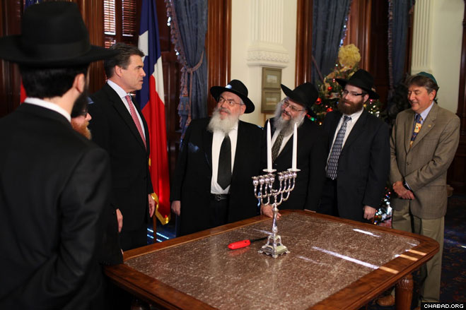 A delegation of Chabad-Lubavitch emissaries led by regional director Rabbi Shimon Lazaroff delivered Chanukah greetings to Texas Gov. Rick Perry at the Texas state capitol in Austin.