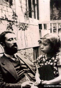 A young Chana Sharfstein sits on the lap of her father, Rabbi Yaakov Yisroel Zuber.