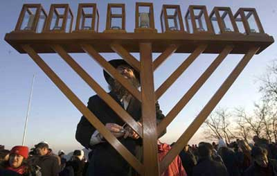 Chabad-Lubavitch emissary in Beijing, China, Rabbi Shimon Freundlich, lights the Chanukah Menorah with his community at the Great Wall of China.