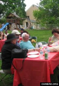 Jewish residents of Chester County, Pa., enjoy a Lag B'Omer barbecue in the yard between the Chabad-Lubavitch Jewish Center and the neighboring Islamic center.