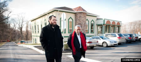 Rabbi Yossi Kaplan of the Chabad-Lubavitch Jewish Center of Chester County and Mohammad Aziz walk in front of the Islamic Center of Greater Valley Forge. (Photo: Jordan Cassway)