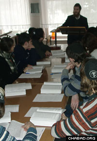 Rabbi Yisroel Silberstein teaches a group of Jewish teenagers in Chernigov, Ukraine.