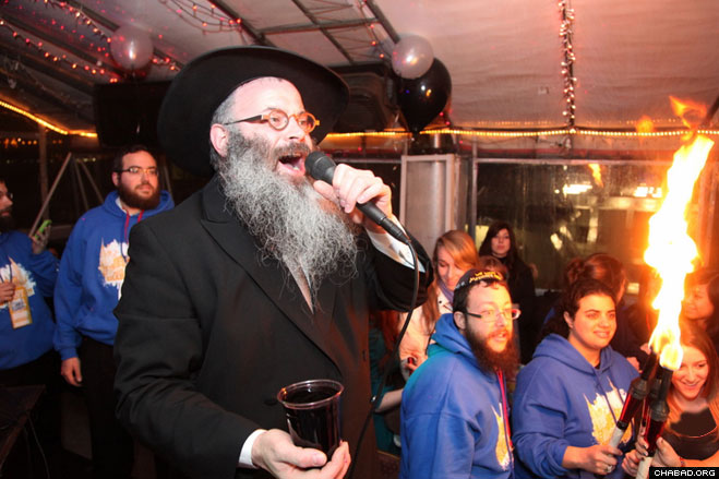 Rabbi Shimon Freundlich of Beijing, China led teens in the blessings marking the end of the Sabbath.