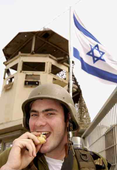 Soldier eating Hamantash.jpg