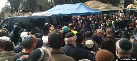 Thousands attend the funeral of Rabbi Udi and Ruth Fogel in Jerusalem Sunday. (Photo: Pana Nichuirc)