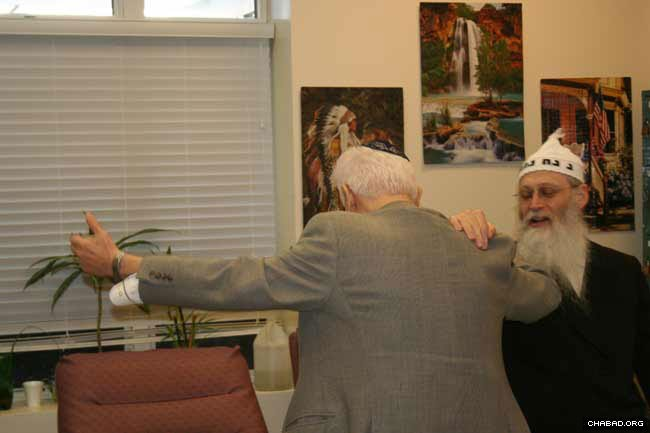 Rabbi Moshe Klein dances with a resident of a Brooklyn, N.Y., home for senior citizens during the holiday of Purim.