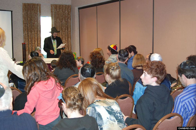 Rabbi Yossi Stein reads the Scroll of Esther for Purim celebrants at the Chabad-Lubavitch Jewish Center of Greater Altoona in western Pennsylvania.