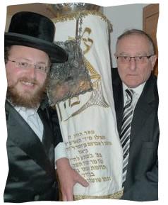 Rabbi Yitzchak Weitz with David Brager and his Torah