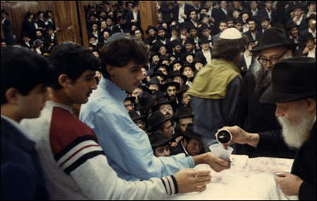 The Rebbe distributes wine.