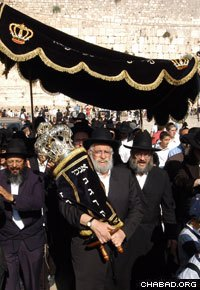 A Children's Torah Scroll is paraded through the Western Wall plaza.