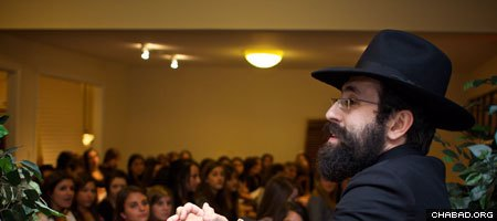 Chabad-Lubavitch of Athens director Rabbi Michoel Refson presides over a gathering of Jewish students at the University of Georgia.