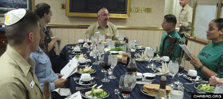 Then-Capt. Herman Shelanski, commander of the USS Harry S. Truman aircraft carrier, presides over a Passover Seder supplied by the Aleph Institute in the Captain's Mess in 2009.